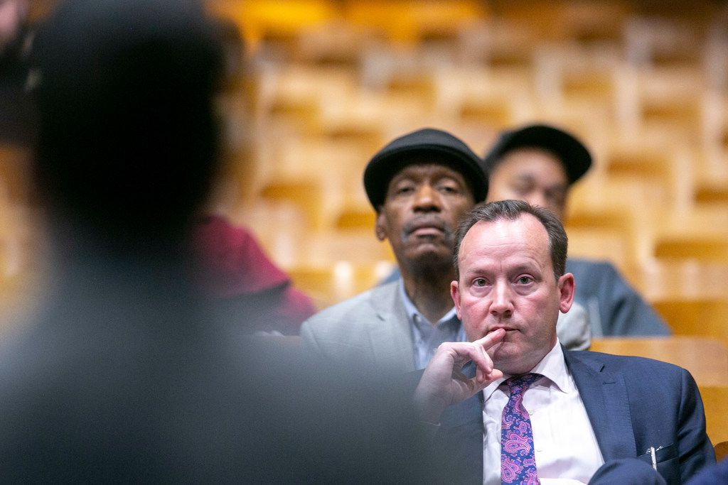 Dallas city councilman Philip Kingston listens as Yesenia Ramirez, Director of Family and Community Engagement at DISD, answers his questions during a Dallas Independent School District community meeting at Pinkston High School on Tuesday, Feb. 12, 2019. DISD is proposing to enter into a partnership with a nonprofit or other entity to operate their school. New state law allows independent school districts to convert a campus or create an in-district charter campus that operates under the school district but the school would manage its day-to-day operations independently from the school district. Those campuses receive more state money. (Shaban Athuman/The Dallas Morning News)