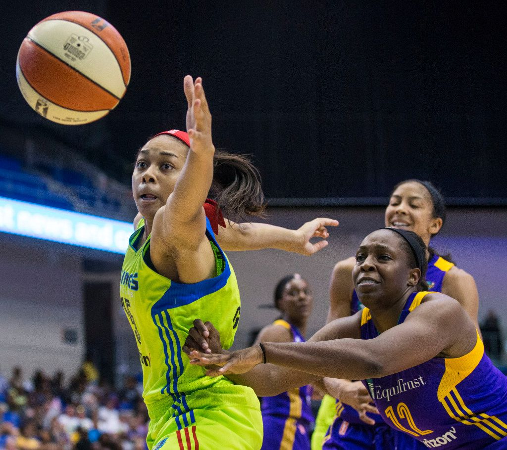 Dallas Wings guard Allisha Gray (15, left) reaches past Los Angeles Sparks guard Chelsea Gray (12) to rebound a missed shot during a WNBA match-up between the Dallas Wings and the Los Angeles Sparks on Sunday, August 6, 2017, at College Park Center, in Arlington, Texas. (Ryan Michalesko/The Dallas Morning News)
