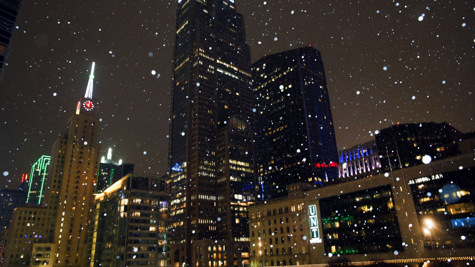 Downtown Dallas looked like the inside of a snow globe in this photo taken Monday evening, Jan. 15, 2018, as a mixture of snow and sleet began falling when a cold front slowly moved across the area.