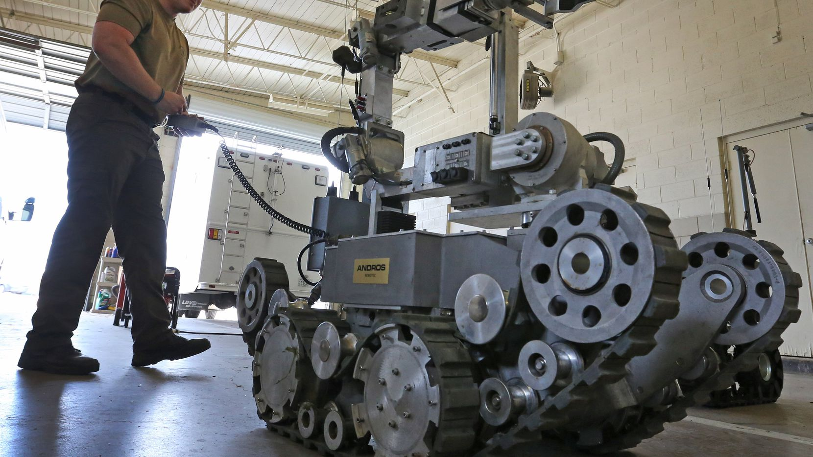 Garland Police Officer Robby Shreves operates the department's bomb robot on Tuesday, May 15, 2018.