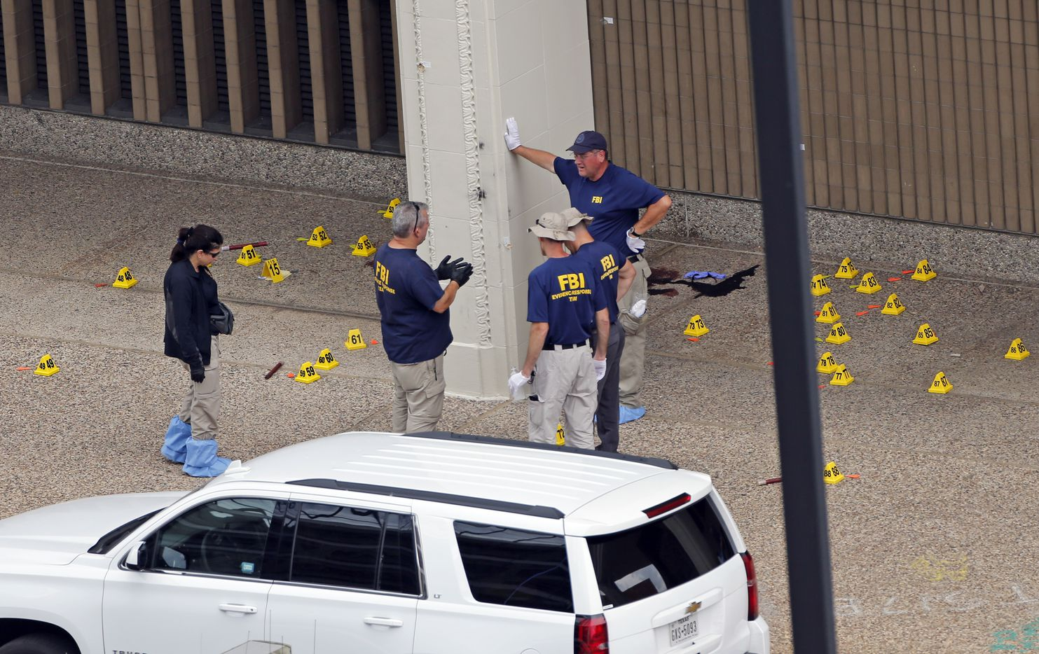 On July 9, two days after the ambush, members of an FBI evidence response team gathered evidence outside El Centro College, where DART Officer Bent Thompson was shot at point-blank range.