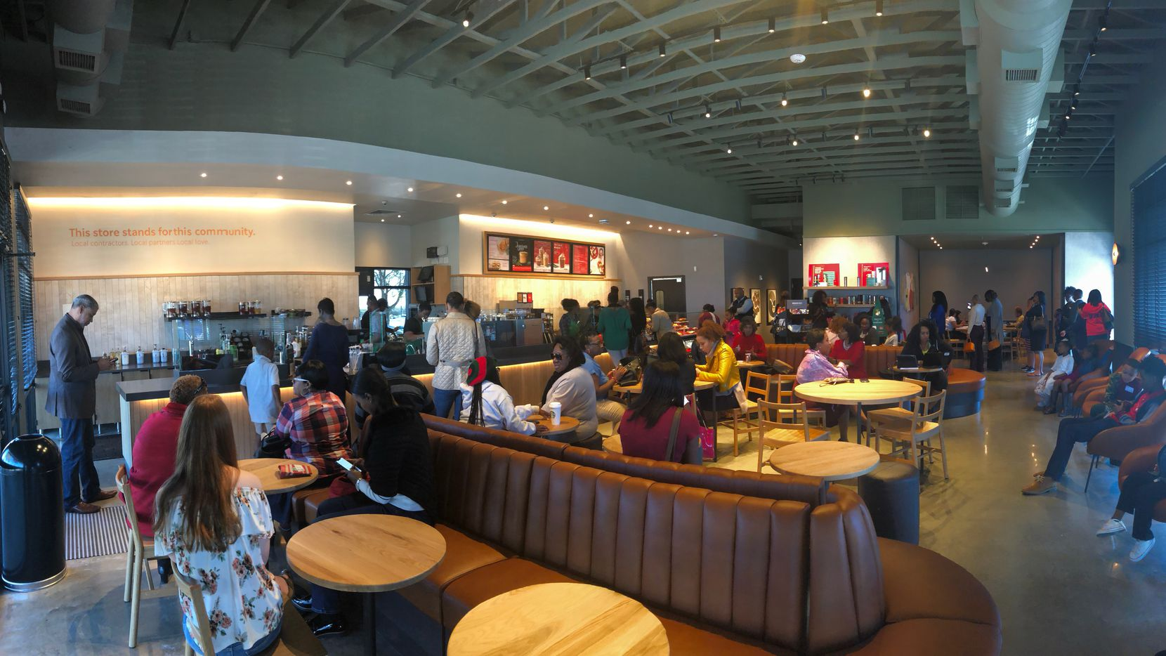 The new Starbucks in Oak Cliff's Red Bird neighborhood drew long lines and lots of excitement during its first few days of business. This was the scene Sunday afternoon.