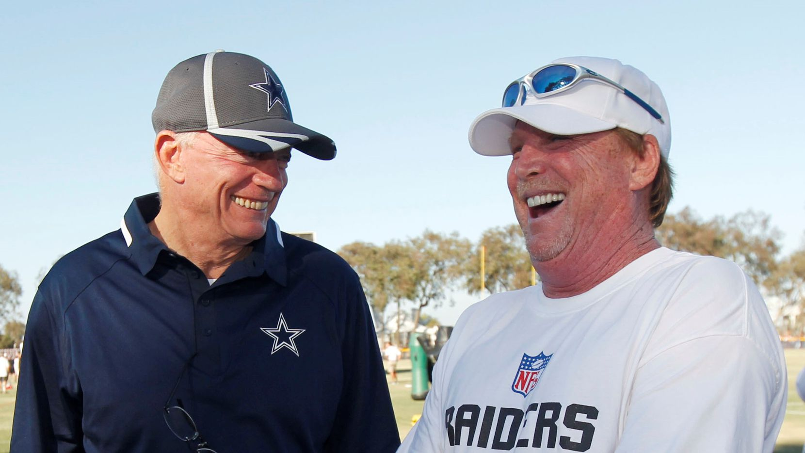 Dallas Cowboys owner Jerry Jones greets Oakland Raider owner Mark Davis (right) during their afternoon practice in Oxnard, CA, on Aug 12, 2014.  (Michael Ainsworth/The Dallas Morning News)