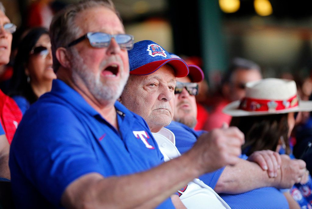 Zonk aka John Lanzillo Jr., 85, (center) watches the Opening Day game as the Texas Rangers played the Chicago Cubs at Globe Life Park in Arlington, Thursday, March 28, 2019. (Tom Fox/The Dallas Morning News)