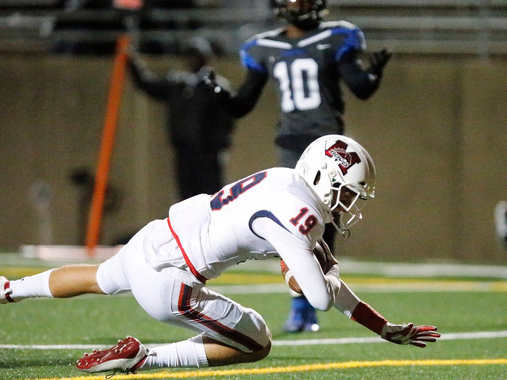McKinney Boyd High School wide receiver Jack Hagan (19)  falls to the ground in the end zone after making the catch during the second half as Plano West High School hosted McKinney Boyd High School at Clark Stadium in Plano on Friday night, October 11, 2019. (Stewart F. House/Special Contributor)