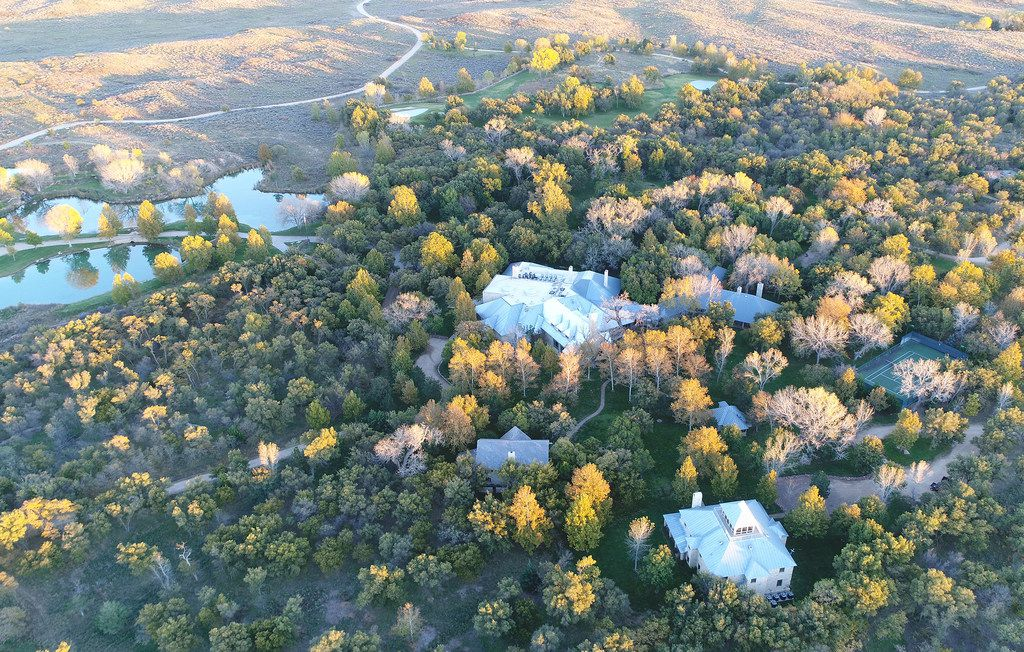 The Mesa Vista ranch has a Lodge compound that includes several structures in a park-like area. The compound includes a lighted tennis court, a skeet/trap range and a small golf course.