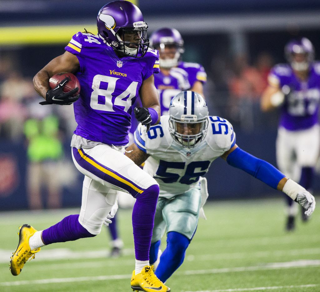 Dallas Cowboys linebacker Keith Smith (56) attempts to tackle Minnesota Vikings wide receiver Cordarrelle Patterson (84) as he runs toward the end zone for a touch down during the second quarter of their game on Saturday, August 29, 2015 in Arlington, Texas.  Patterson ran for a 107 yard touch down. (Ashley Landis/The Dallas Morning News)