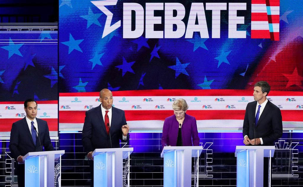 Sen. Cory Booker (D-N.J.) (second from left) speaks as former housing secretary Julian Castro (left), Sen. Elizabeth Warren (D-Mass.) and former Texas congressman Beto O'Rourke look on during the first night of the Democratic presidential debate on June 26, 2019 in Miami, Fla.  A field of 20 Democratic presidential candidates was split into two groups of 10 for the first debate of the 2020 election, taking place over two nights, hosted by NBC News, MSNBC and Telemundo. (Joe Raedle/Getty Images)