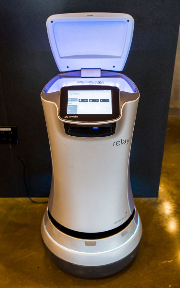 """A Savioke Relay robot butler, nicknamed """"botler,"""" made to help with deliveries to guest rooms sits at it's charging dock on Thursday, March 9, 2017 at Aloft and Element Dallas Love Field hotel in Dallas. The hotel will be part of West Love, an ongoing 37-acre mixed-use development. (Ashley Landis/The Dallas Morning News)"""