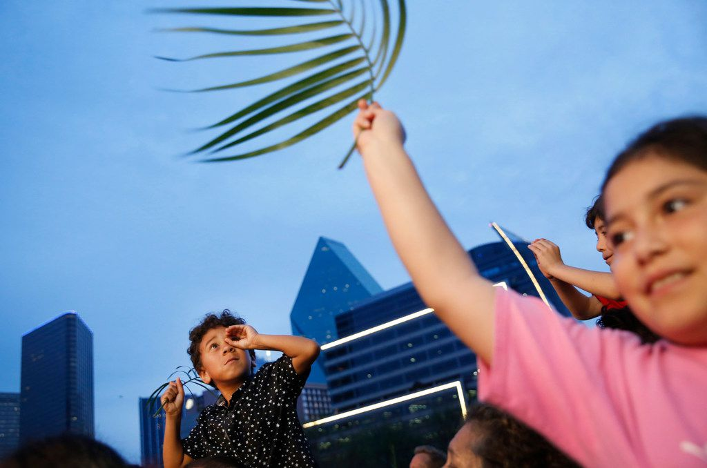 Chris Aguilar, 6, looks across the crowd during the March for Eternal Life led by members of First Baptist Dallas at Klyde Warren Park in downtown Dallas on Palm Sunday, March 25, 2018. The march comes a day after the March for Our Lives protest for stricter gun control. (Rose Baca/The Dallas Morning News)