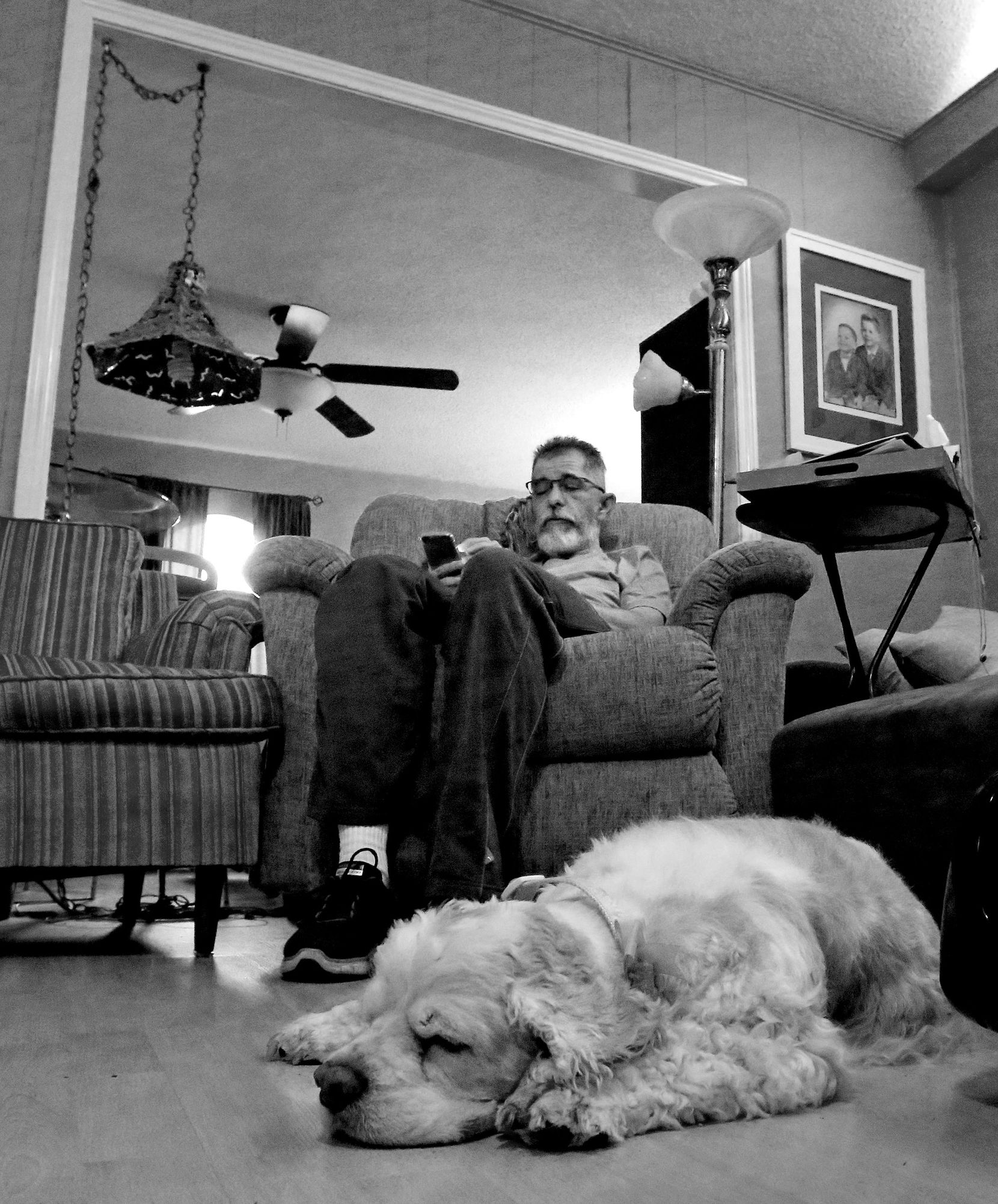 Weiss scans social media while relaxing at his home. (Louis DeLuca/Staff Photographer)