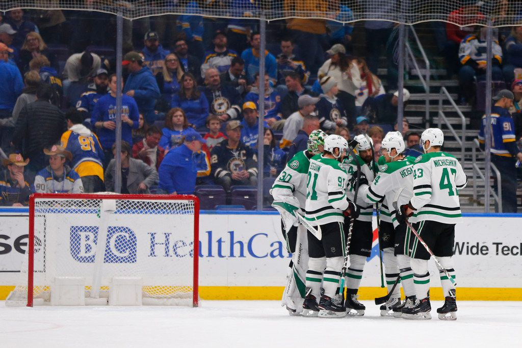 Dallas Stars' Jamie Benn (14) is congratulated by his teammates after recording a hat trick against the St. Louis Blues, during the third period of an NHL hockey game Saturday, March 2, 2019, in St. Louis. (AP Photo/Dilip Vishwanat)