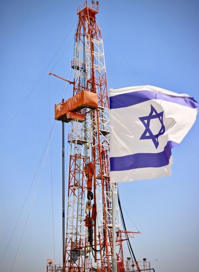 An Israeli flag flies next to the Megiddo-Jezreel #1 well drilled by Zion Oil & Gas. This is the Dallas-based company's latest effort to find oil in Israel, a country with no proven oil reserves. The 17-year-old faith-based Zion was inspired by biblical prophecy and continues to attract investors even without generating revenue. The drilling of Megiddo-Jezreel #1 started June 5.