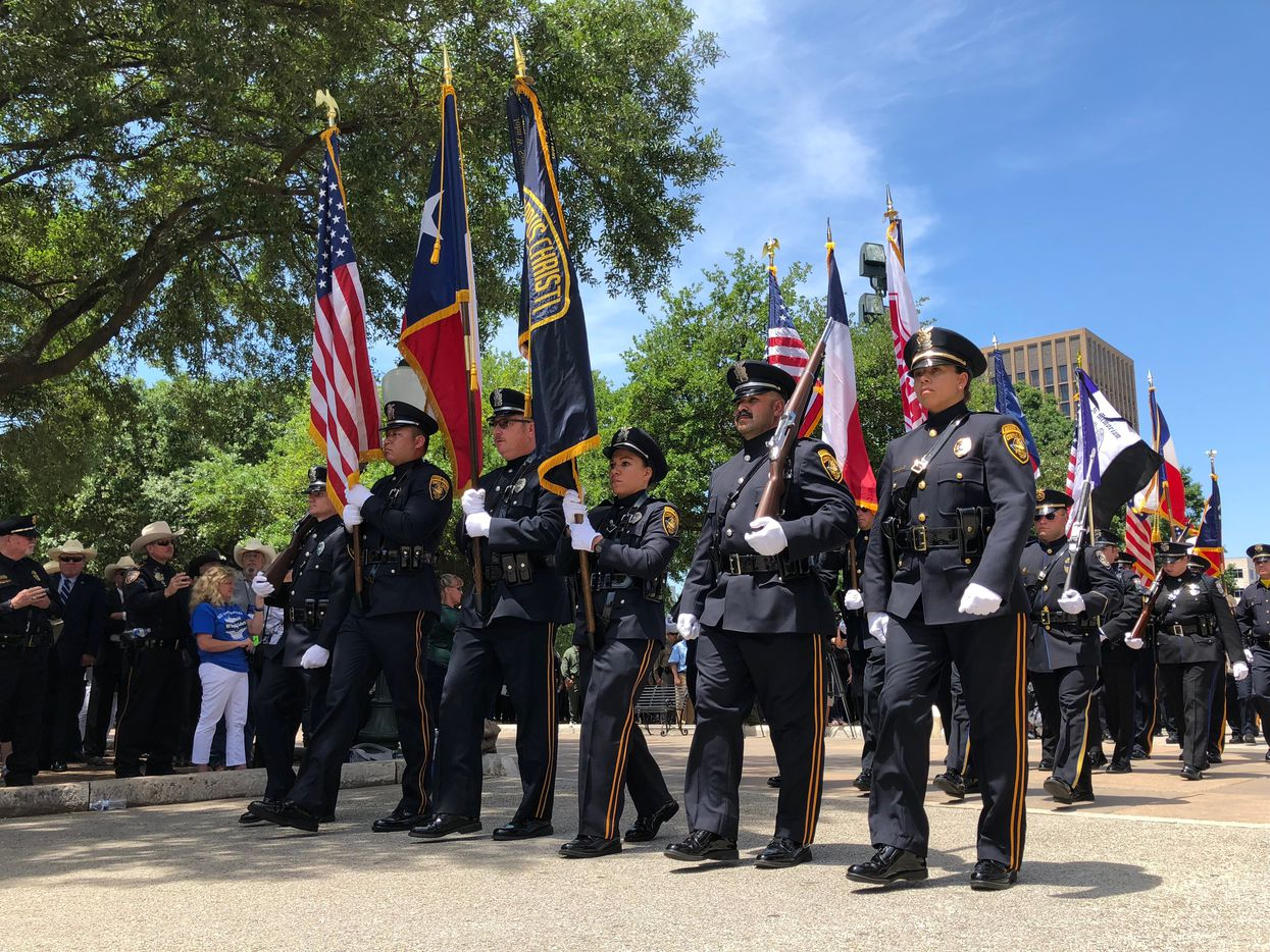 Members of the color guard walk away from the Capitol as the Texas Peace Officers' Memorial ceremony ends Monday, May 7, 2018, in Austin, Texas.
