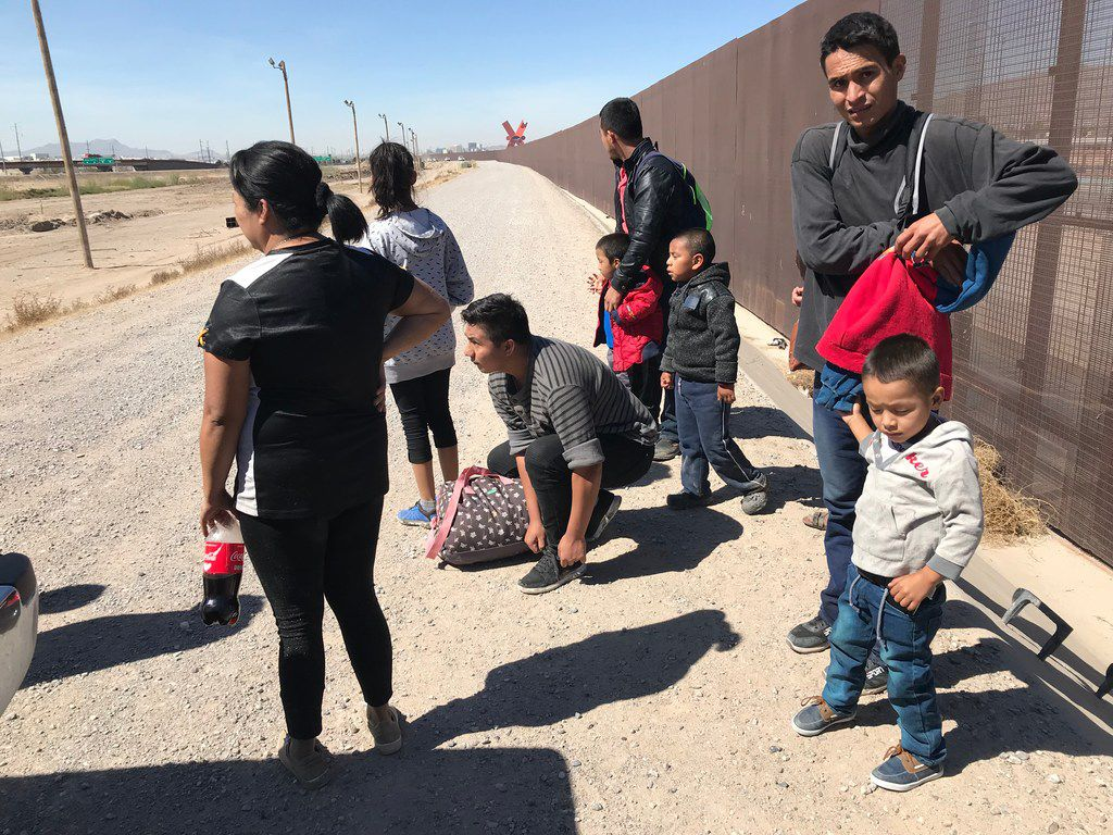Migrants who crossed the border and turned themselves in to the border patrol were being held along the fence in an area known as El Paso's Lower Valley in the Ysleta area on March 6, 2019.