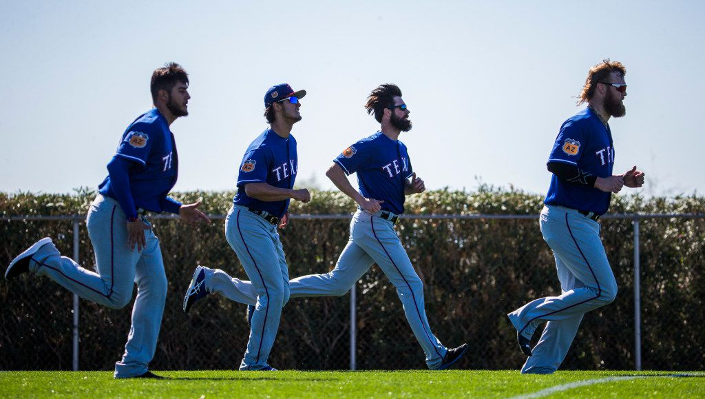 Texas Rangers starting pitcher Martin Perez (33), starting pitcher Yu Darvish (11), starting pitcher Cole Hamels (35) and starting pitcher Andrew Cashner (54) run during a spring training workout at the team's training facility on Tuesday, February 15, 2017 in Surprise, Arizona. (Ashley Landis/The Dallas Morning News)