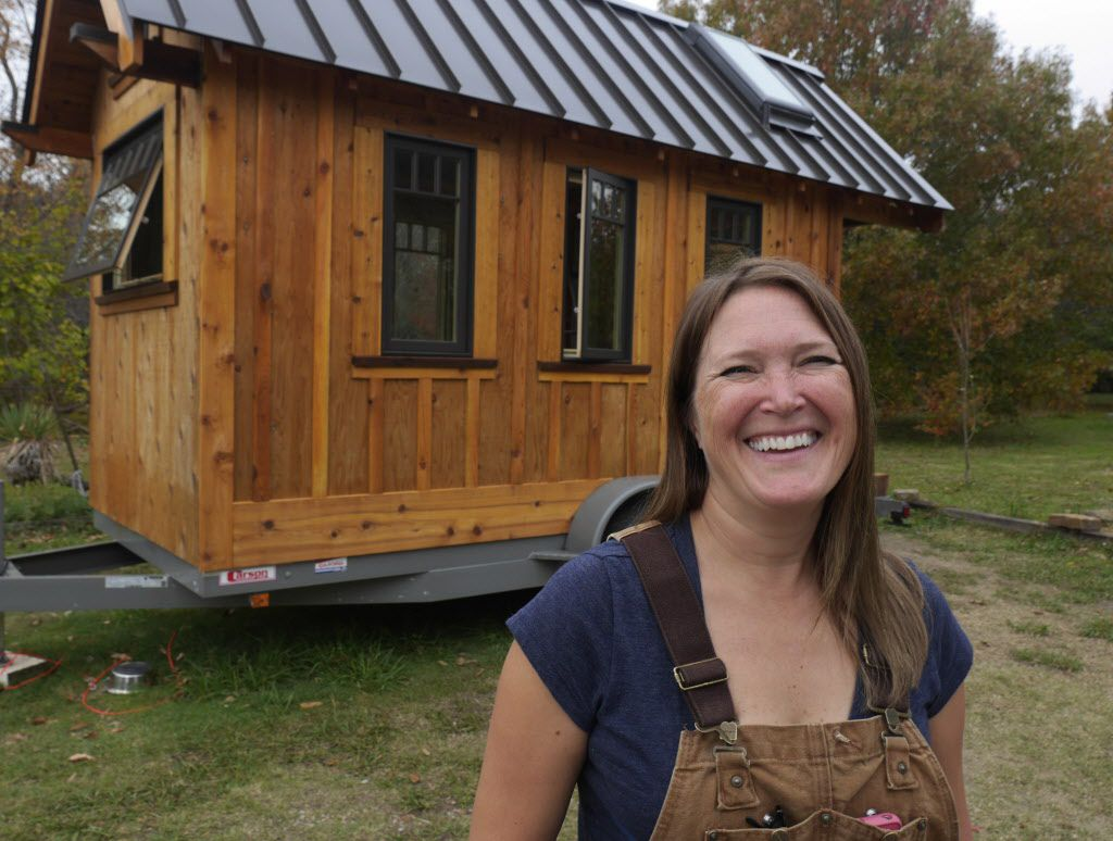 B.A. Norrgard photographed Thursday November 21, 2013 with the tiny house she is building in Garland. The house is under 150 square feet.
