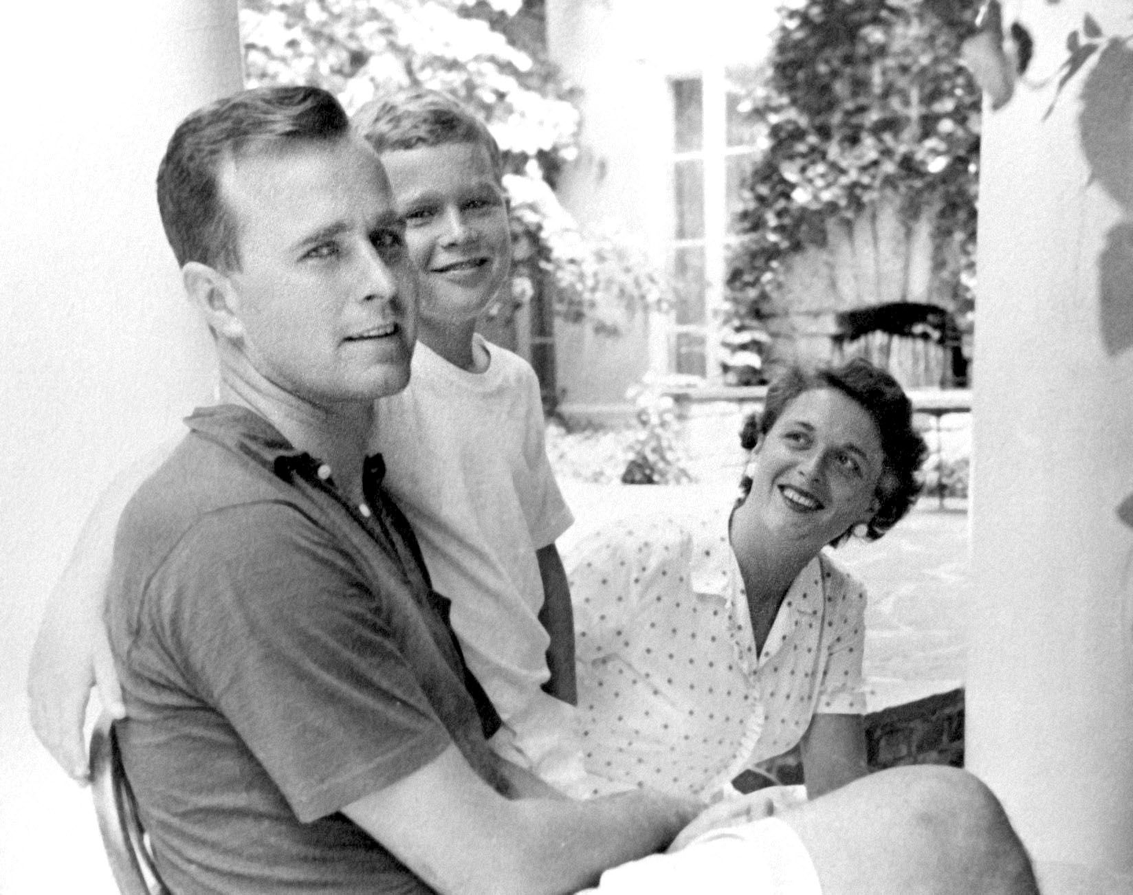 """George W. Bush (center), born in 1946, was the first of George H. W. and Barbara Bush's six children. Their second child, Pauline Robinson """"Robin"""" Bush (1949-1953), died of leukemia."""