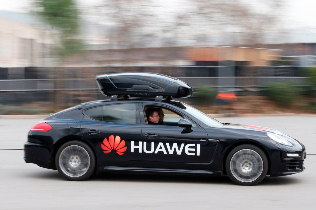 A Huawei Mate 10 Pro smartphone is used to drive a Porsche Panamera outside the Camp Nou stadium in Barcelona on the first day of the Mobile World Congress.