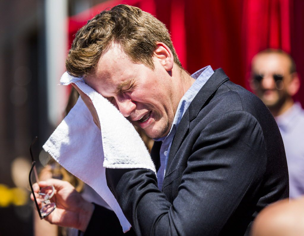 Author John Green wipes away sweat on the red carpet outside a promotional event for Paper Towns, a movie based on the book by John Green, on Thursday, July 16, 2015 at Bomb Factory in Dallas.