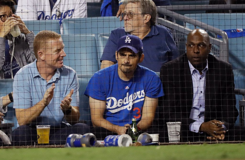 Country singer Brad Paisley and Dallas Cowboy coach Jason Garrett watch Game 3 of the World Series baseball game between the Boston Red Sox and Los Angeles Dodgers on Friday, Oct. 26, 2018, in Los Angeles. (AP Photo/David J. Phillip)