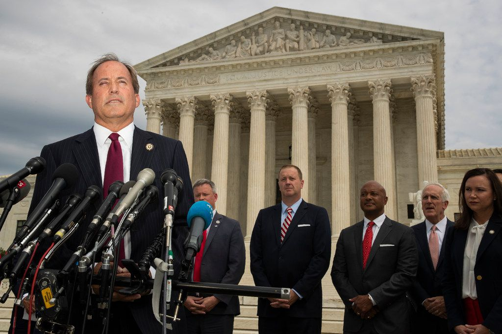 Texas Attorney General Ken Paxton and a bipartisan group of state attorneys general speaks to reporters in front of the U.S. Supreme Court in Washington, Monday, Sept. 9, 2019 on an antitrust investigation of big tech companies.