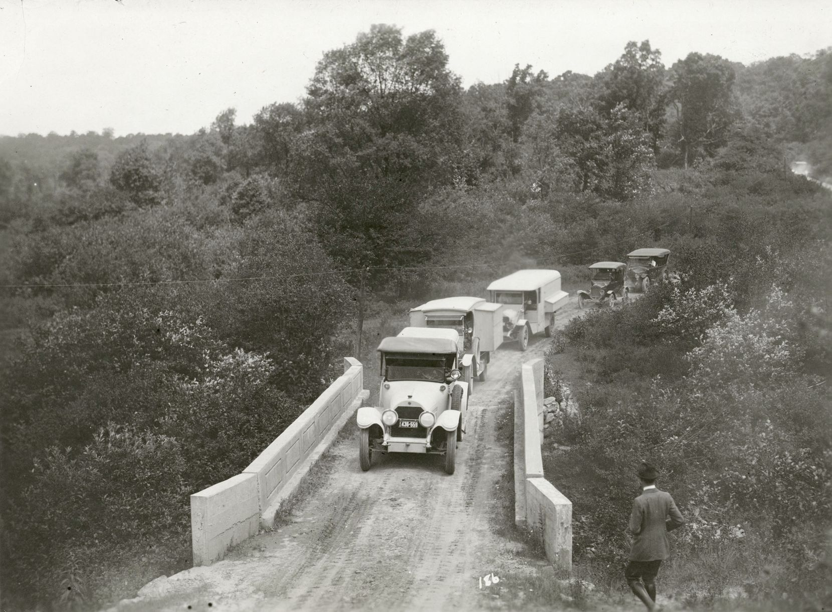 The caravan crosses a bridge while carrying Henry Ford, Thomas Edison and others on one of their road trips.