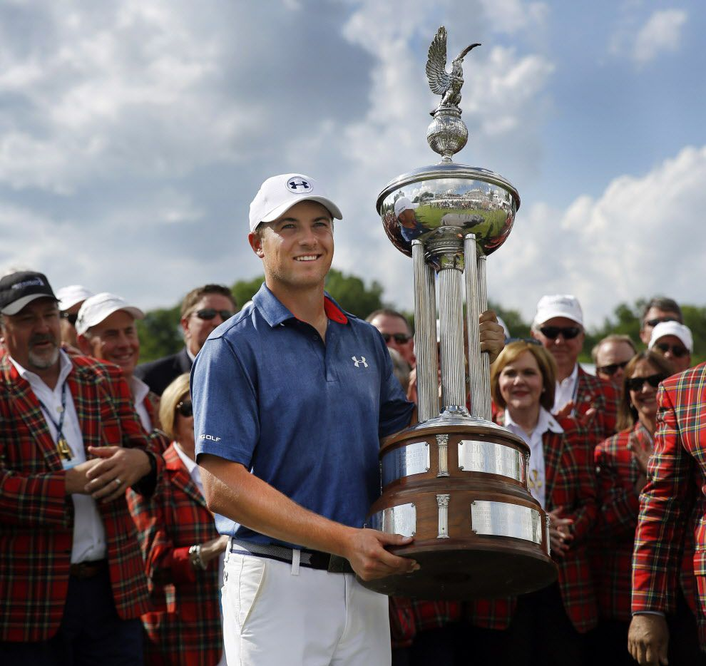 Jordan Spieth holds up the Marvin Leonard trophy after winning the Dean and Deluca Invitational at the Colonial Country Club in Fort Worth, Sunday, May 29, 2016. (Tom Fox/The Dallas Morning News)