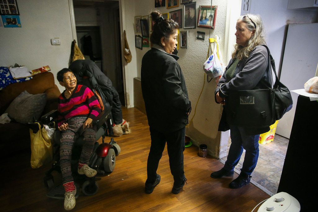 Kimberly Nam (center), a Khmer translator from the Dallas Police Department, translates for Soun Yath (left), a resident at Bryan Song Apartments, during a visit by Sandy Rollins of the Texas Tenants' Union.