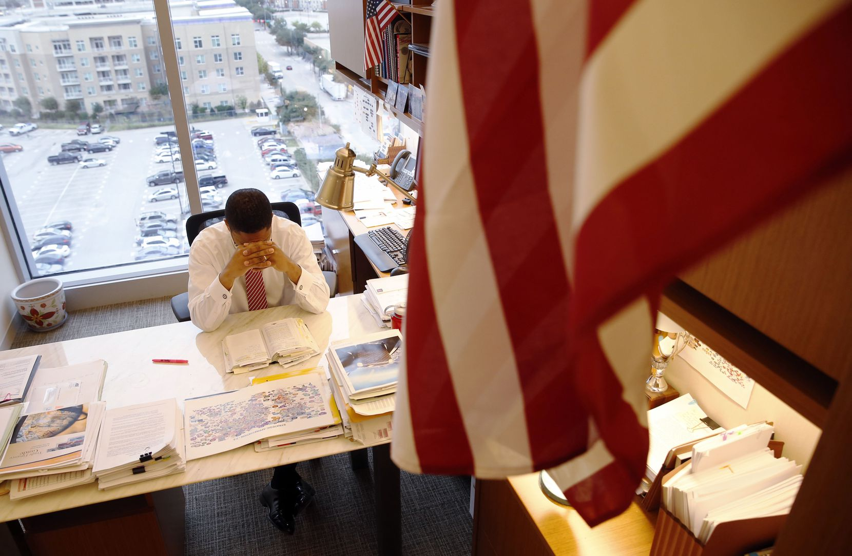 James Waters reads his daily devotional in his office in downtown Dallas. (Vernon Bryant/Staff Photographer)
