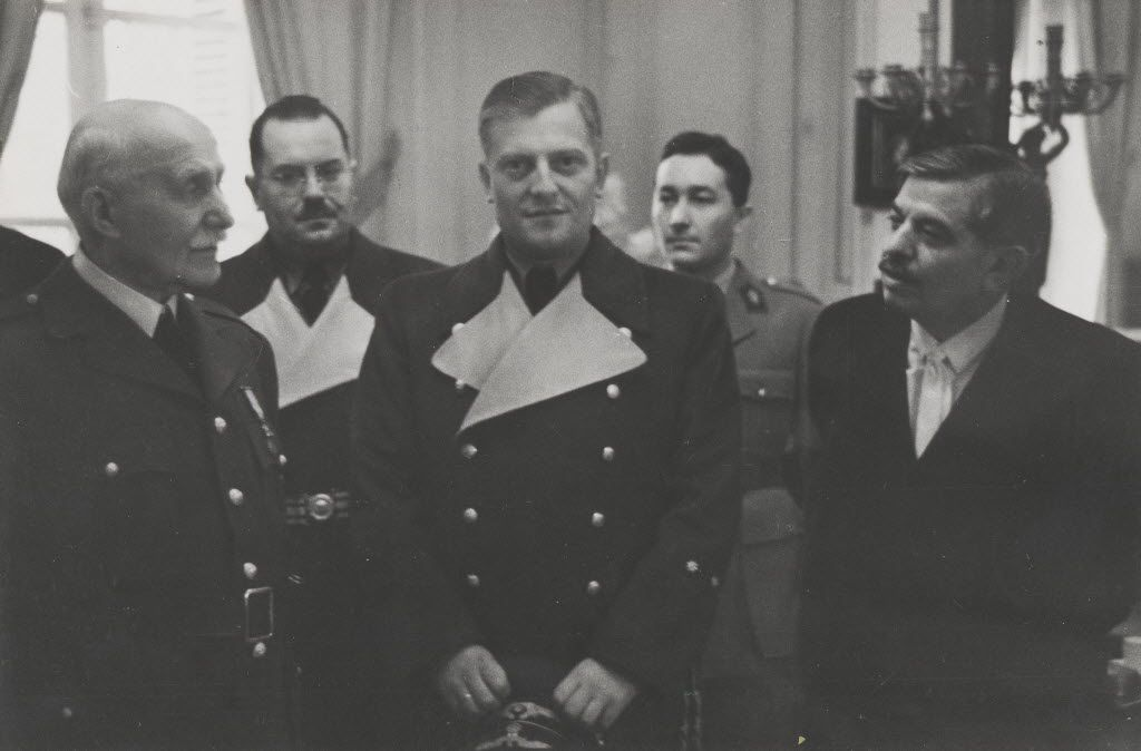 From left: Marshal Philippe Petain; the German ambassador, Otto Abetz; and the Vichy chief minister, Pierre Laval, in an undated photo from the exhibition Collaboration 1940-1945 at the National Archives in Paris.