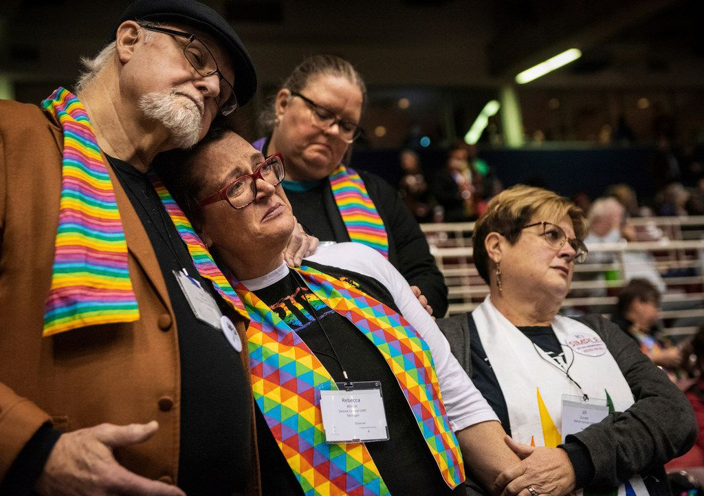 Ed Rowe (from left), Rebecca Wilson, Robin Hager and Jill Zundel react to the defeat of a proposal that would allow LGBT clergy and same-sex marriage within the United Methodist Church at the denomination's 2019 Special Session of the General Conference in St. Louis, Mo.