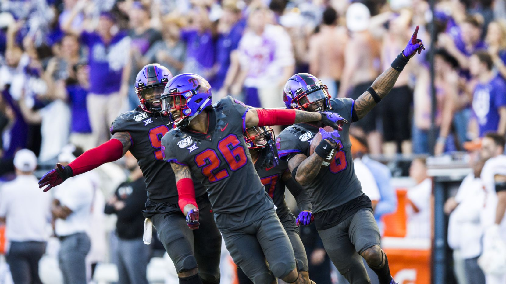 TCU Horned Frogs celebrate after safety Innis Gaines (6) caught an interception that clinched a TCU win during the fourth quarter of an NCAA football game between the University of Texas and TCU on Saturday, October 26, 2019 at Amon G Carter Stadium in Fort Worth. TCU won 37-27.