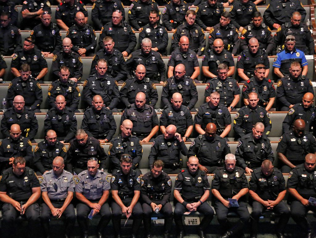 "Law enforcement officers sat in the church as the pass by ceremony started at the funeral service for Dallas Police Department Senior Cpl. Earl James ""Jamie"" Givens, held at Prestonwood Baptist Church in Plano on Thursday, July 26, 2018."