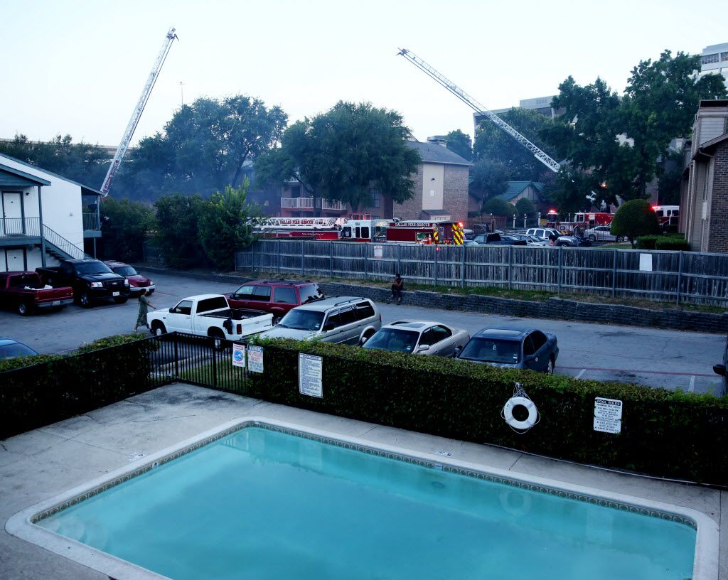 Dallas Fire-Rescue personnel worked to put out Monday's fire at the Landmark at Rosewood Apartments.