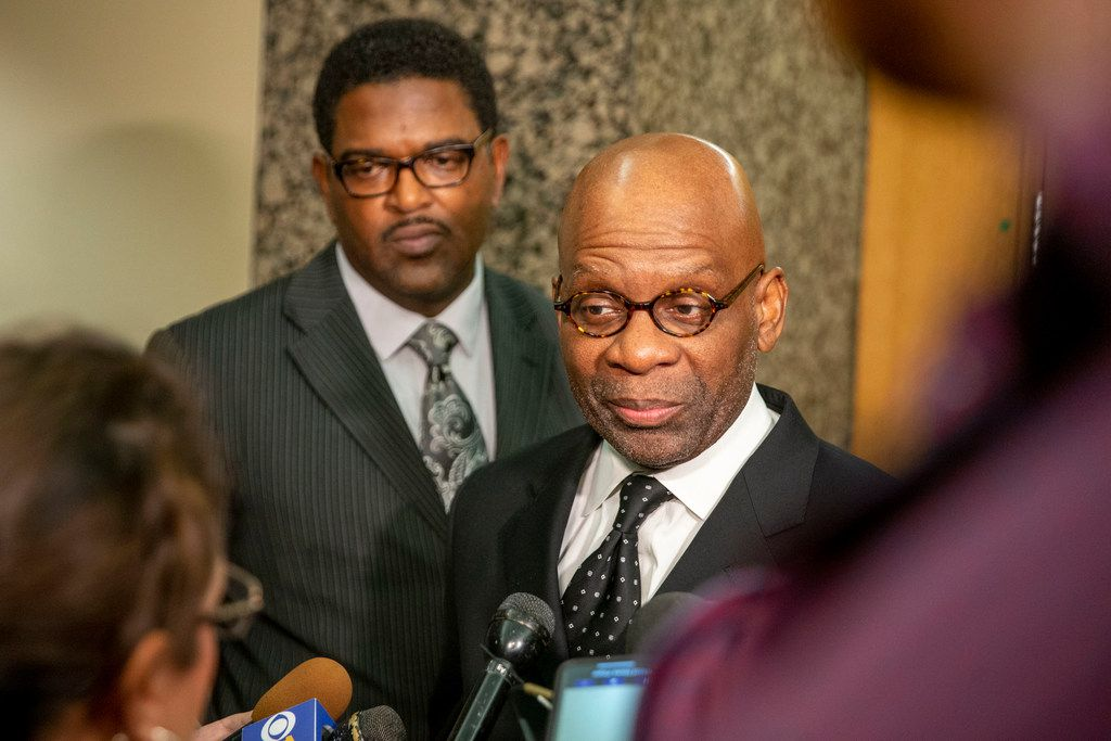 Sini Mathews' lawyers, Heath Harris (left) and Philip B. Parker, gave remarks during a news conference after a January bond reduction hearing in Dallas.