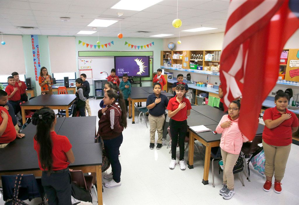 Math and science teacher Natalia Rodriguez Perez's fifth-grade class says the Pledge of Allegiance.