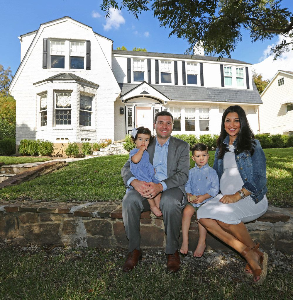 Tony and Ashley Ruggeri pose with their children Juliana and Michael on the front lawn at of their home at 6935 Lakeshore in Dallas.