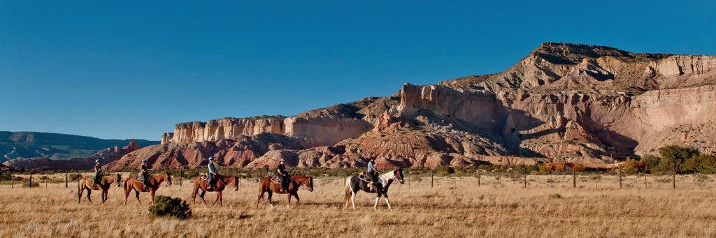 Horseback riders hit the trail at Ghost Ranch, the former summer home of artist Georgia O'Keeffe, in Abiquiu, N.M.