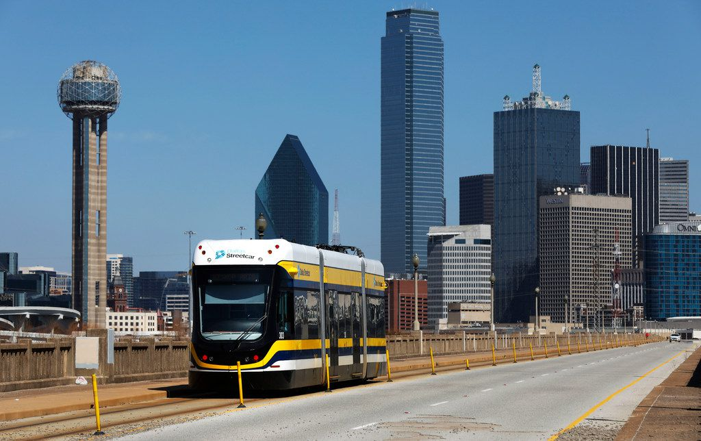 The Dallas Streetcar makes its way across the Houston Street viaduct to Oak Cliff out of downtown Dallas, on Feb. 26. The Dallas City Council is considering a fare for the streetcar, which is currently free.