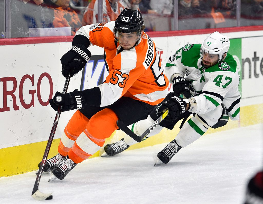 Philadelphia Flyers' Shayne Gostisbehere, left, skates past Dallas Stars' Alexander Radulov during the first period of an NHL hockey game, Saturday, Dec. 16, 2017, in Philadelphia. (AP Photo/Derik Hamilton)