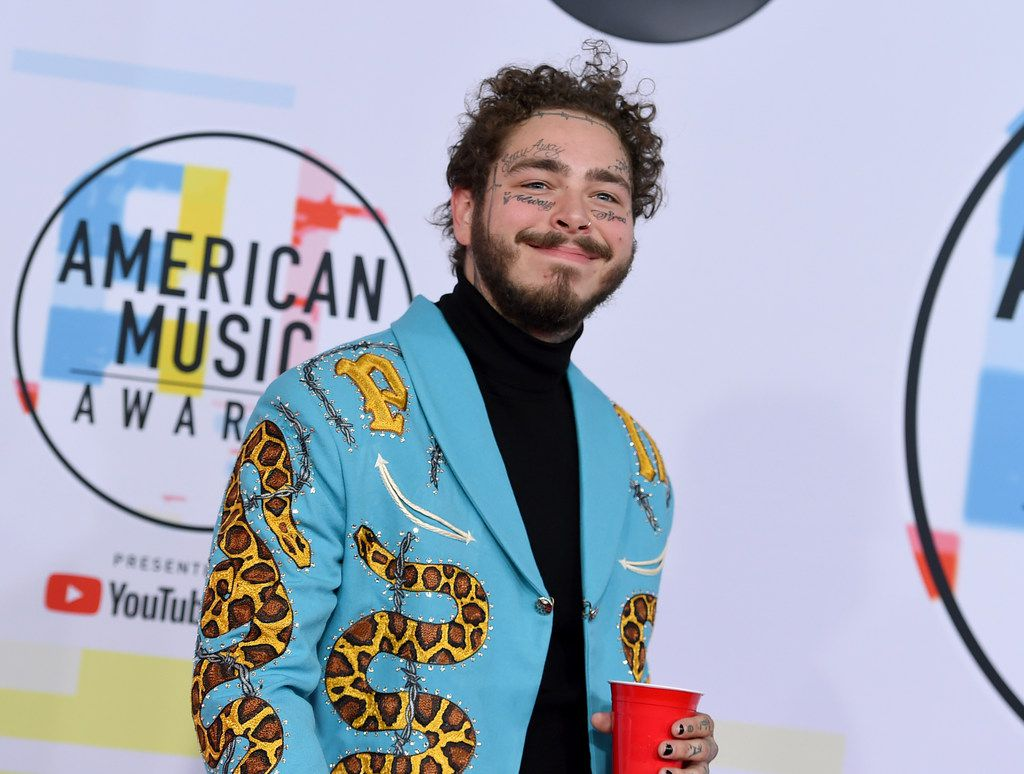 Post Malone arrives at the American Music Awards on Tuesday, Oct. 9, 2018, at the Microsoft Theater in Los Angeles.
