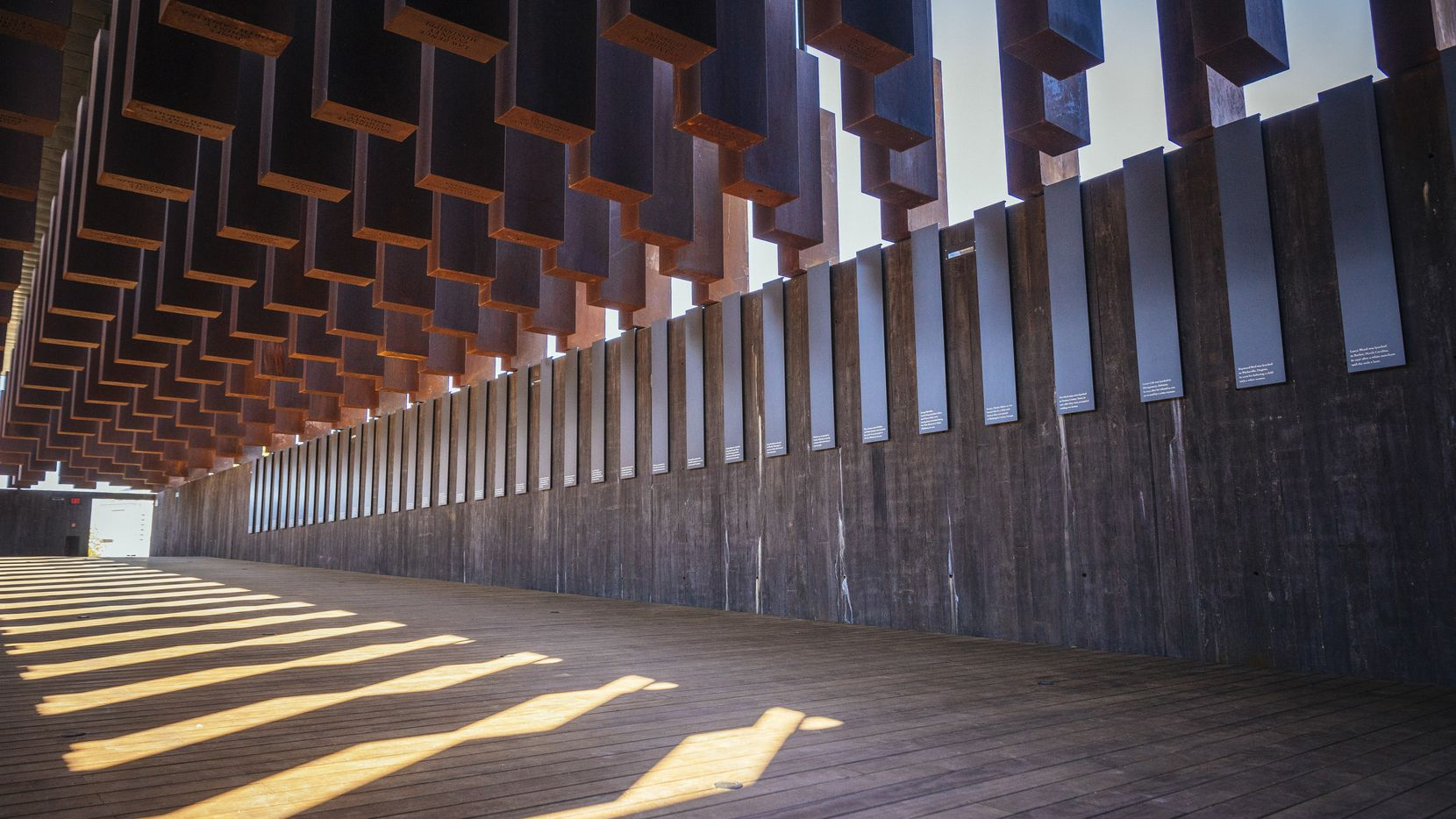 Eight hundred weathered steel columns, each one etched with the names of a lynching victim, hang from the roof of the new National Memorial for Peace and Justice in Montgomery, Ala.