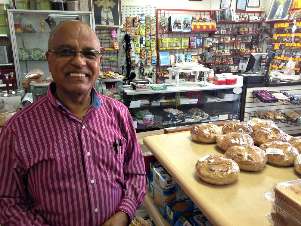 Kassahun Maru at the Vickery Meadow grocery store he's owned and operated since 1993