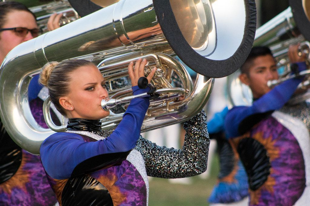 A Blue Knights tuba player performs with her section during their 2017 show.