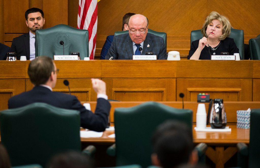 Commissioner of Education Mike Morath (left) answers questions from members of the senate committee on SB3, which would give teachers a $5,000 pay raise next year, at a senate committee hearing on Monday, February 25, 2019 at the Texas state capital extension in Austin.  Senator Juan Hinojosa of McAllen is center, and Senator Jane Nelson of Flower Mound is at right. (Ashley Landis/The Dallas Morning News)