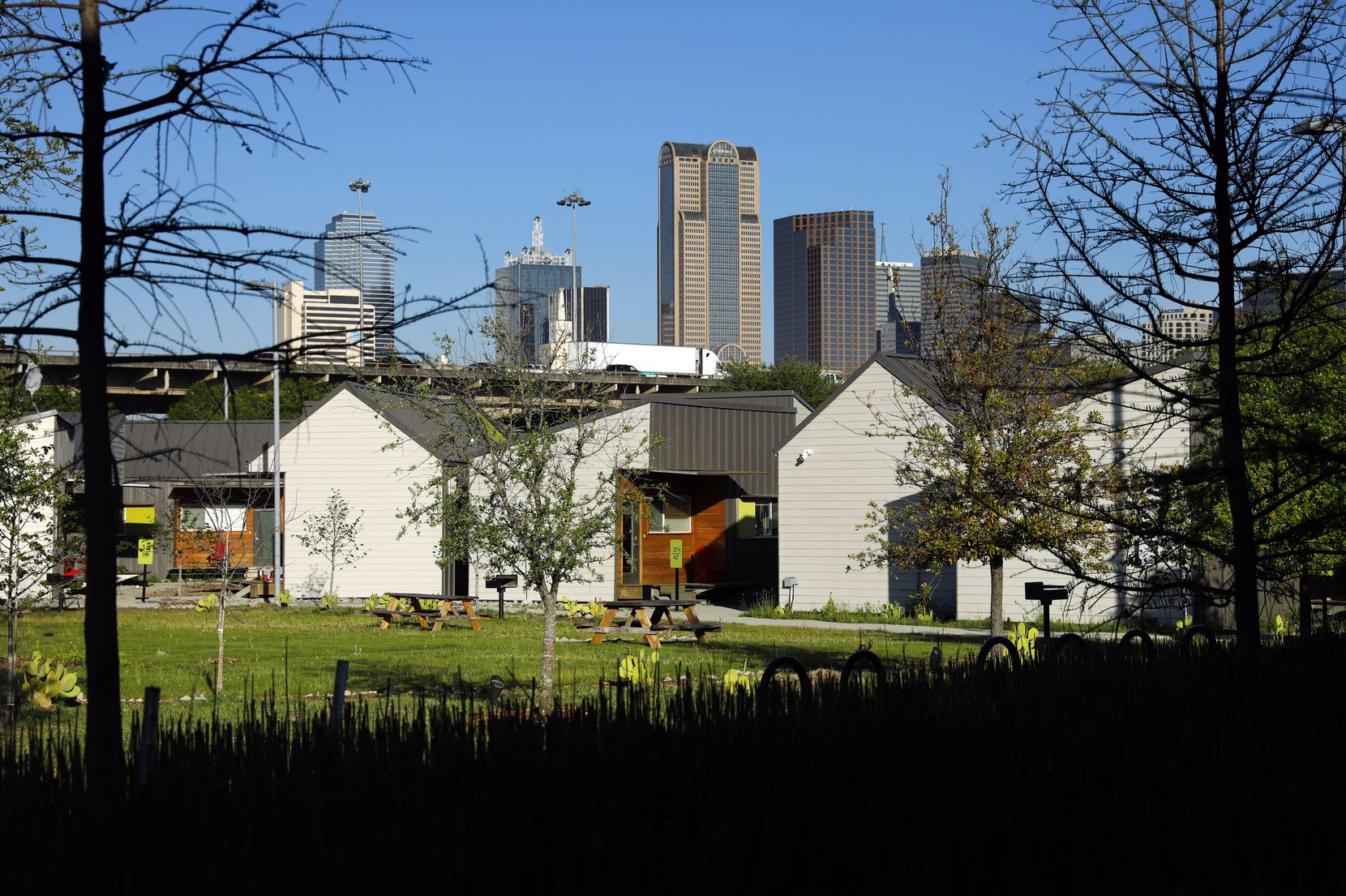 The Dallas skyline rises above the Cottages at Hickory Crossing, which are located on the southeast corner of Interstate 35E and Interstate 45 in Dallas.