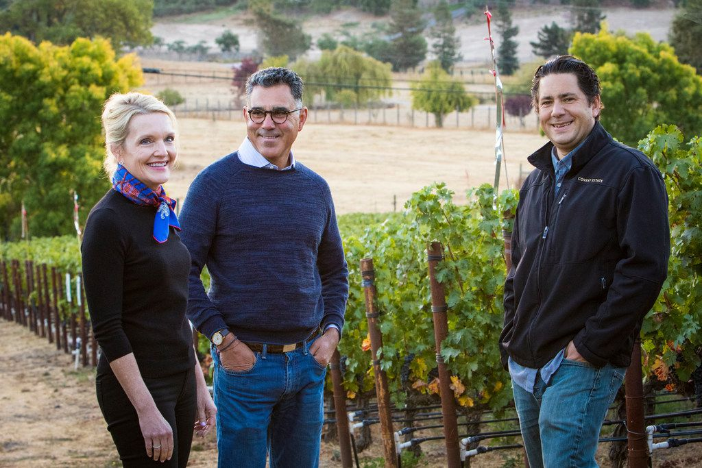 Margaret and Joe Valenzuela (at left), the owners of Rubia Wine Cellars, stand in one of the Napa Valley vineyards of Julien Fayard, their winemaker.