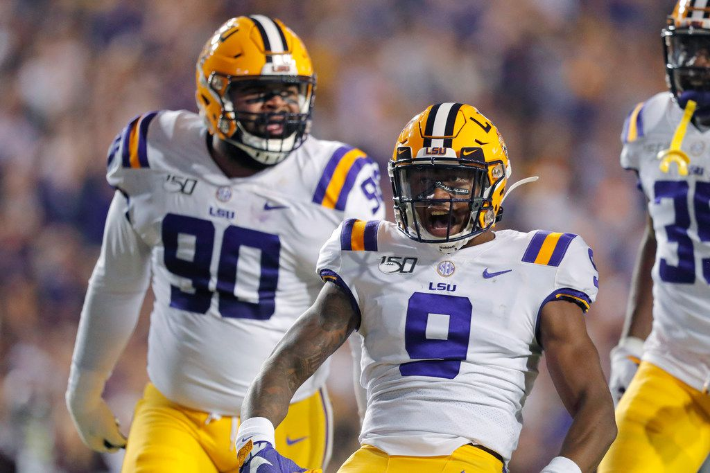 LSU safety Marcel Brooks (9) and defensive lineman Rashard Lawrence (90) celebrate a sack during the first half of an NCAA college football game against Texas A&M in Baton Rouge, La., Saturday, Nov. 30, 2019. (AP Photo/Gerald Herbert)