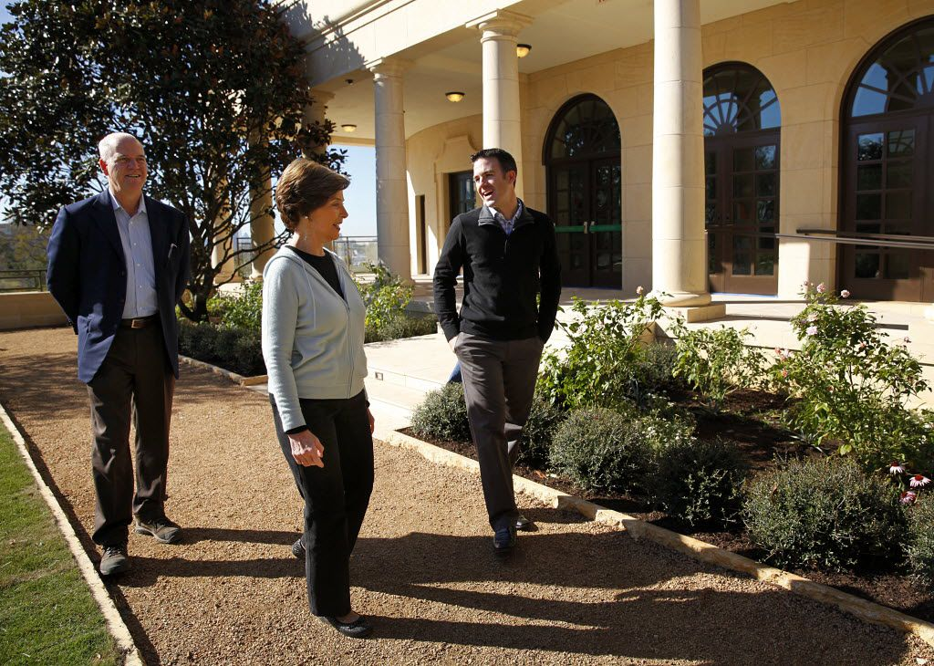 Former first lady Laura Bush walks through the Texas Rose Garden with Herb Sweeney, landscaping project manager from Michael Van Valkenburgh Associates, right, and Mark Langdale, president of the George W. Bush Foundation, at the still-under-construction George W. Bush Presidential Center at SMU, Monday, October 29, 2012.